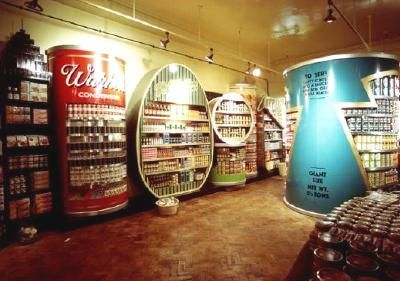 Where Andy Warhol had elevated commercial design by putting the image of a Campbell's soup tin on a gallery wall, Biba now returned his work to the supermarket shelves, turning it indeed into the shelving itself, with a giant display unit for tinned soup labelled Warhol's Condensed. Alongside were oversized cans of baked beans, sardines and frankfurters.