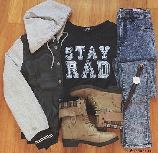 STAY RAD tee with dark washed high waisted jeans, brown boots, and varsity jacket