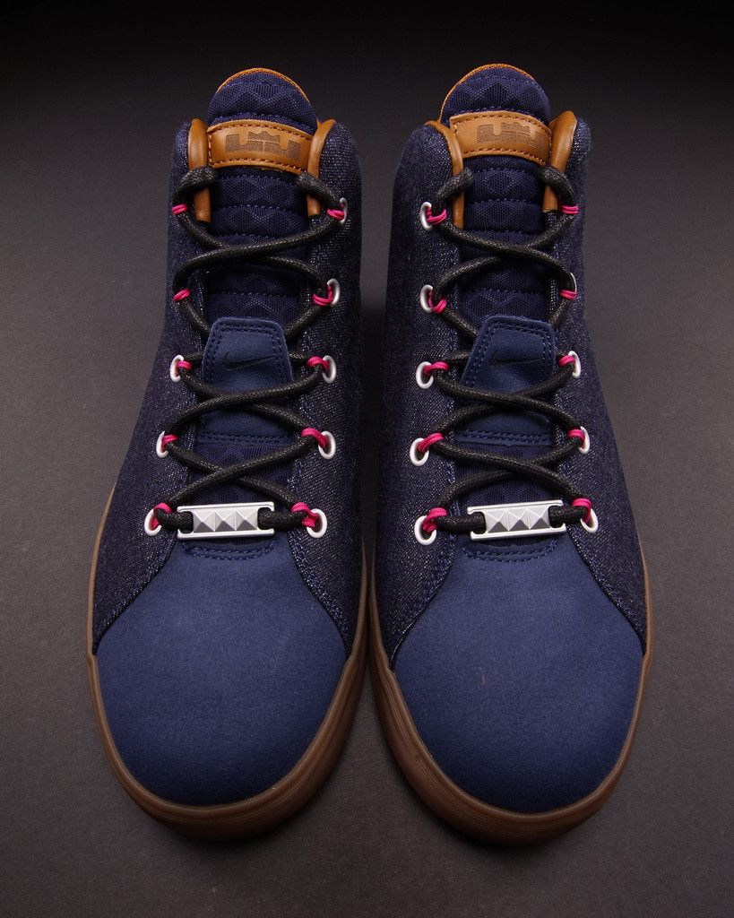 The Nike LeBron 12 NSW Lifestyle DENIM releases this month at NSW accounts,  sporting a navy denim upper, contrast brown leather accents, and pink  Flywire.