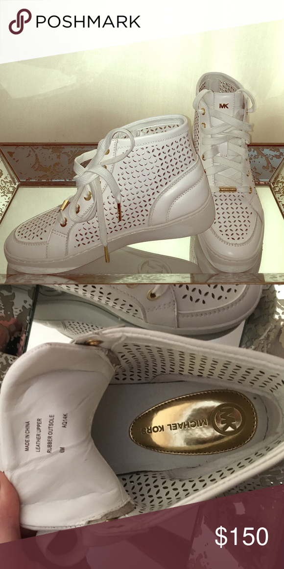 Michael Kors Perforated High Top Sneakers NWOT. Beautiful white preforated high top sneakers with gold accents. Leather upper, rubber outsole. Perfect to pair with jean shorts or a casual dress. Michael Kors Shoes Sneakers
