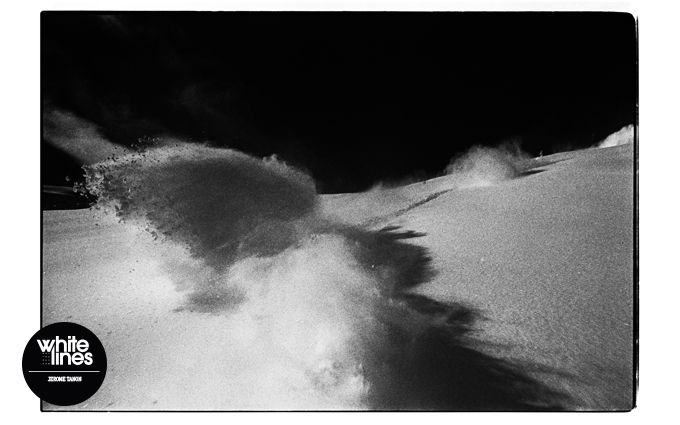 Fim photography master Jerome Tanon shoots his own sprays on a powder descent, bootiful.