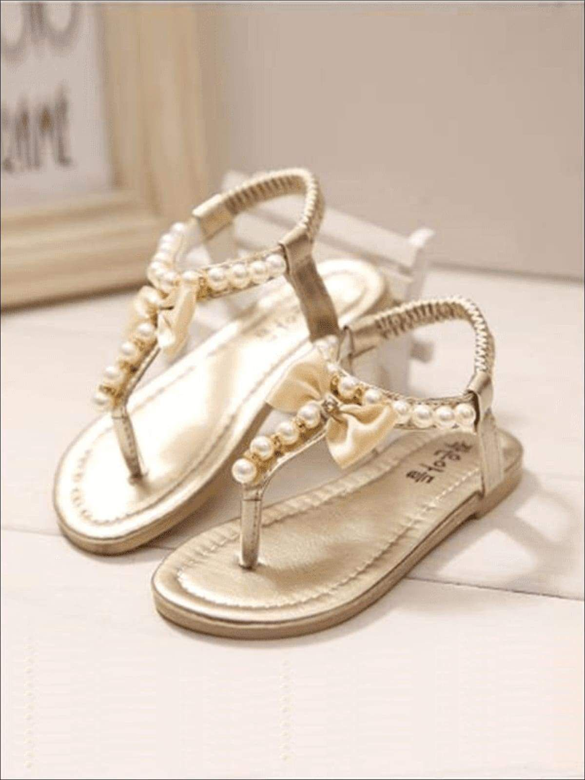 Girls Bow Pearl Trimmed Stretch Sandals By Liv and Mia | Flower girl shoes,  Bridal sandals, Stretch sandal