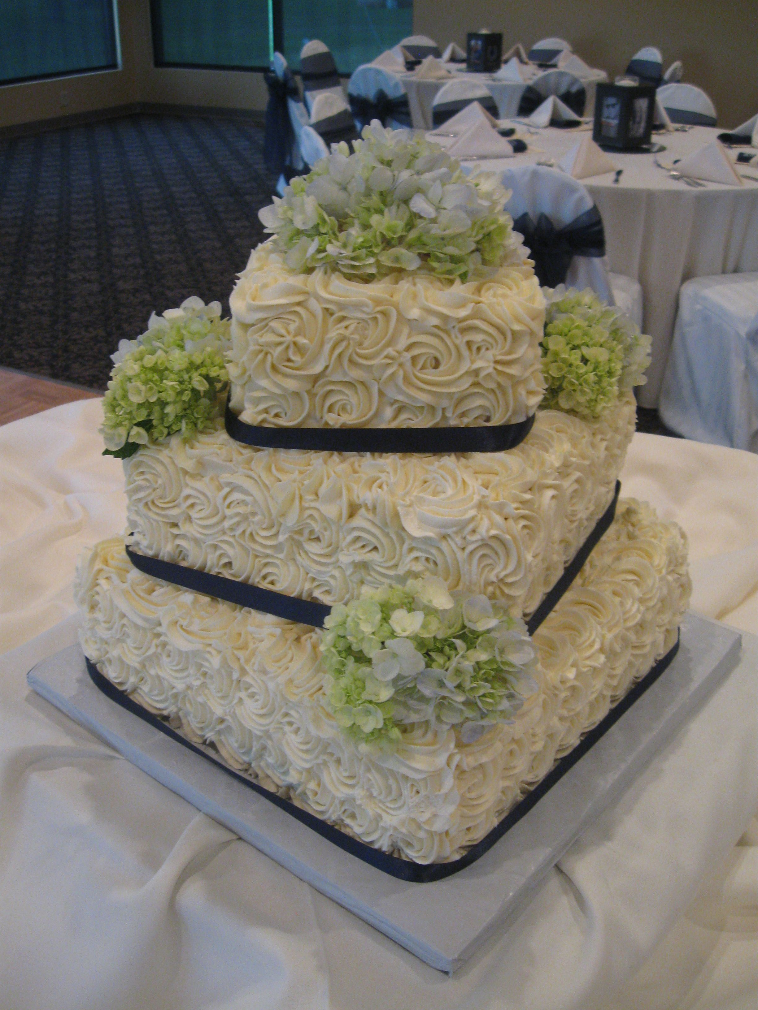 Buttercream rose wedding cake with hydrangeas congrats to paul and