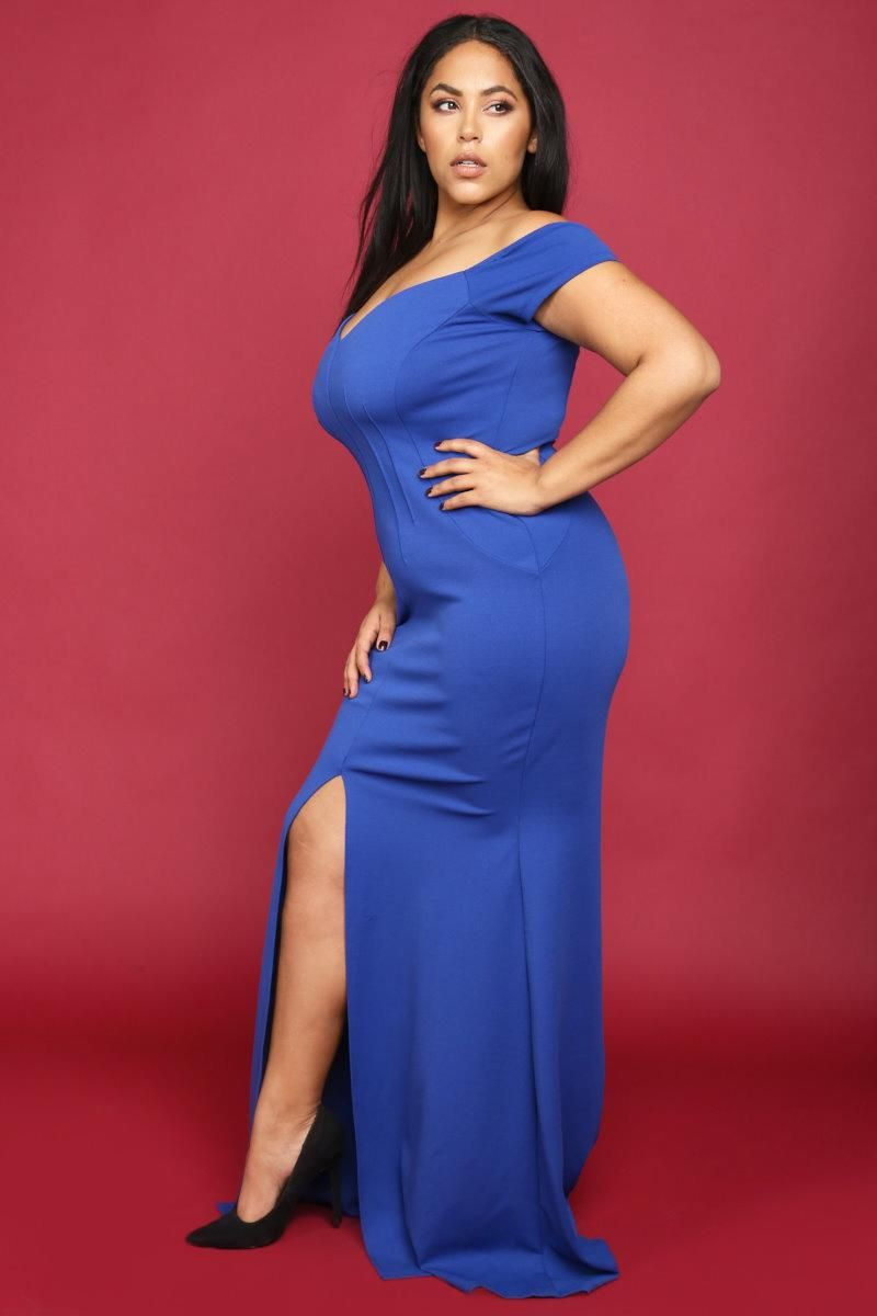 A plus size maxi mermaid dress with a sweetheart neckline and short