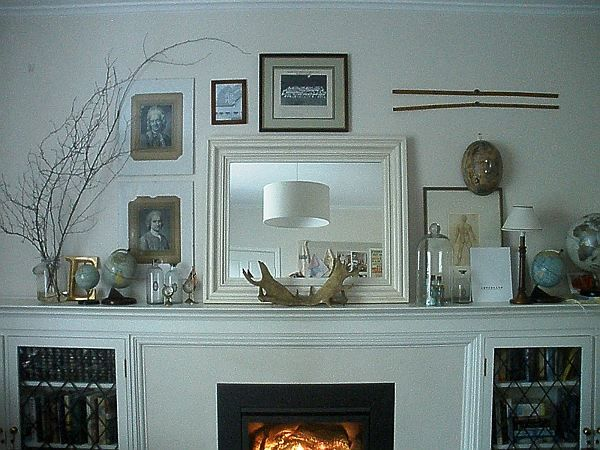 white fireplace mantels decorating with globe and mirror ~ http