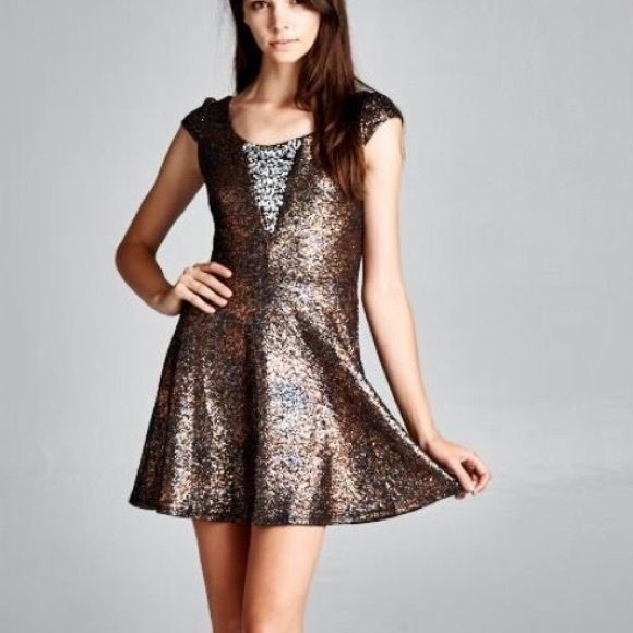 Rose Gold Sparkly Holiday Skater Dress NWOT **PLEASE DO NOT PURCHASE THIS LISTING, I WILL CREATE ONE IN YOUR SIZE*** I ONLY have this rose gold (more of a red tint vs yellow) in one of each : S,M,L. Super soft dress, lined with black material. Front sewn on jewel accents at chest (Not glued!). I can't get over how SOFT these dresses are!! 90%Polyester. Dry cleaned recommended. Perfect for holiday parties & New Years! Darling skater dress. NWOT. Dresses