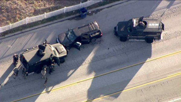 SWAT vehicles near SUV driven by suspect and accomplice. San Bernardino, CA 12/2/2015