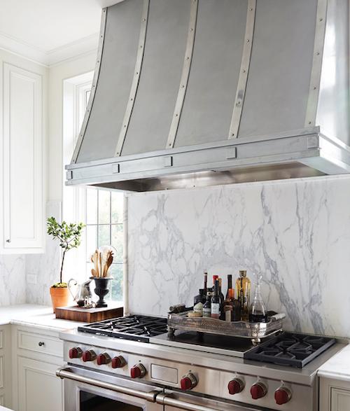 Zinc-french-kitchen-hood-marble-slab-stove-backsplash