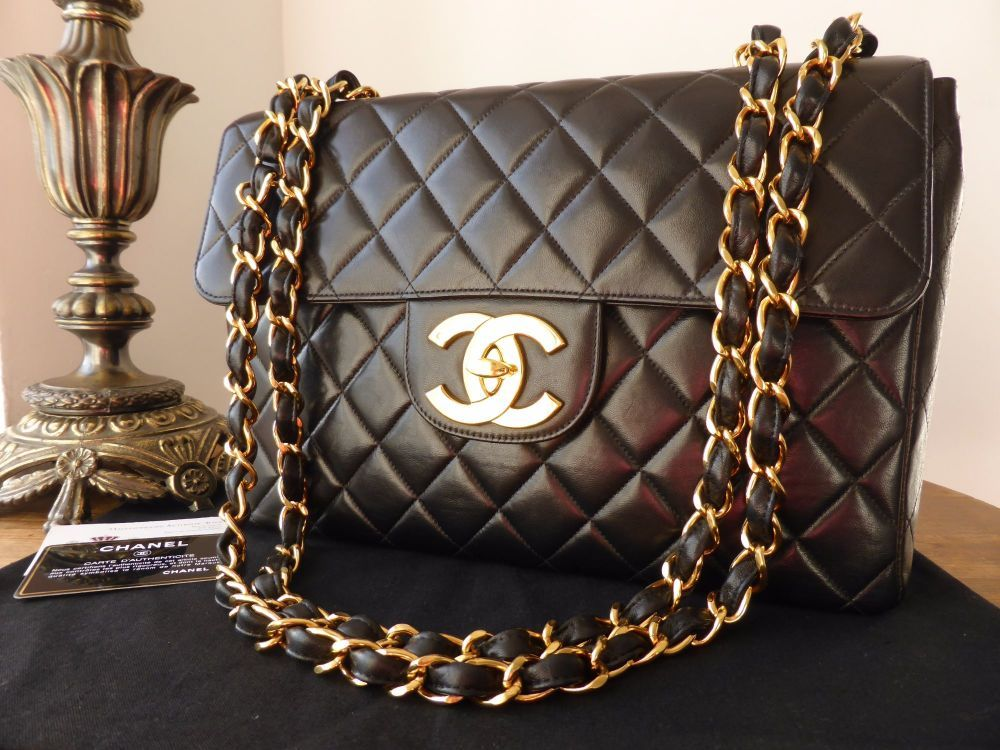 62ae47969c56 Chanel Vintage Jumbo Single Flap Bag in Black Lambskin with Gold Hardware.  Gorgeous 24K Gold