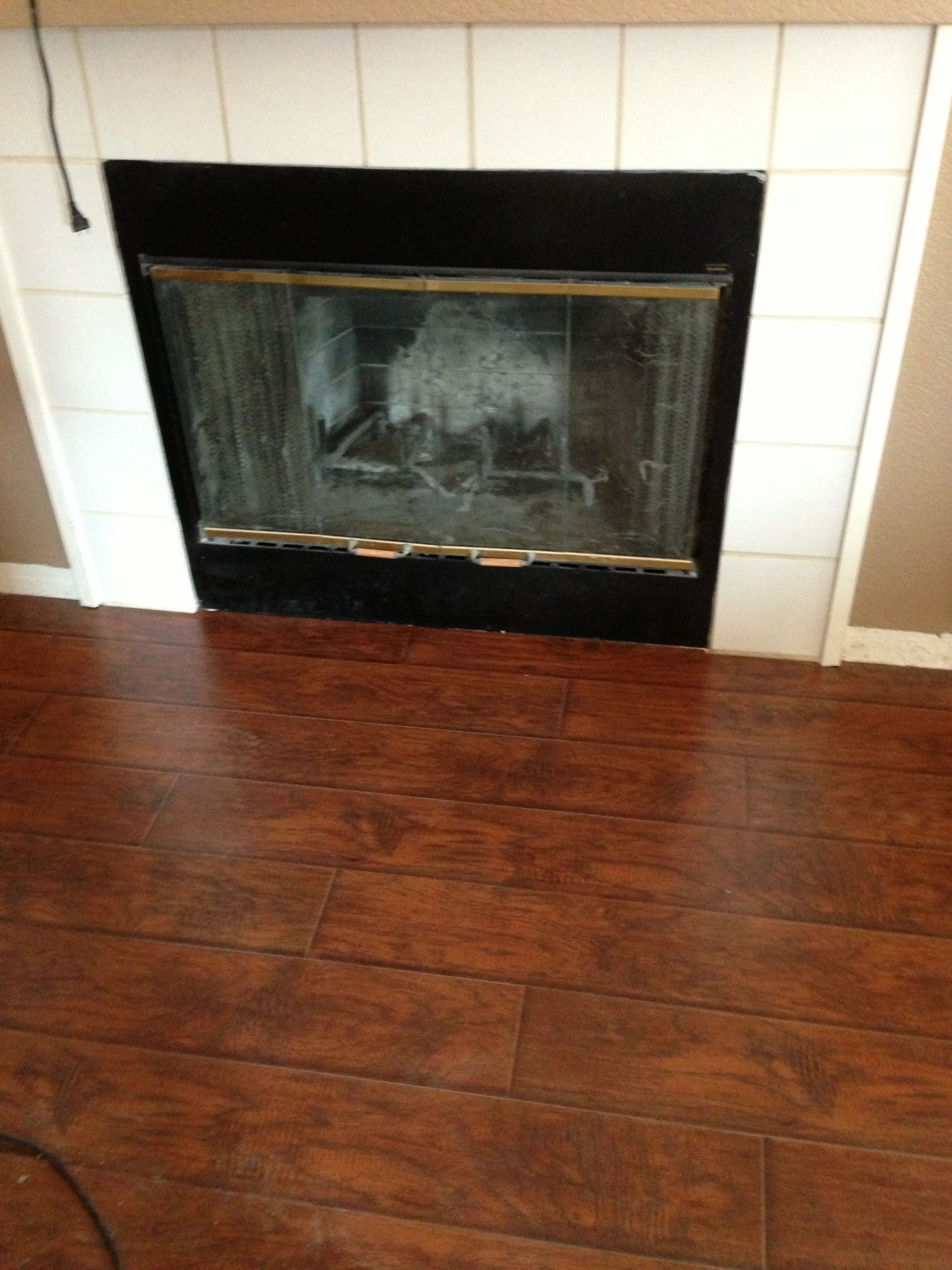 Tile Out Flooring In Front Of Fireplace