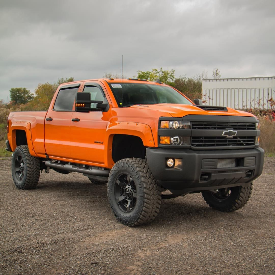 Big Bad And Bright Here S Another Shot Of The Tangier Orange Silverado 2500 Fabtech Motorsports Nittotire Chevy Vehicles Diesel Trucks Custom Trucks