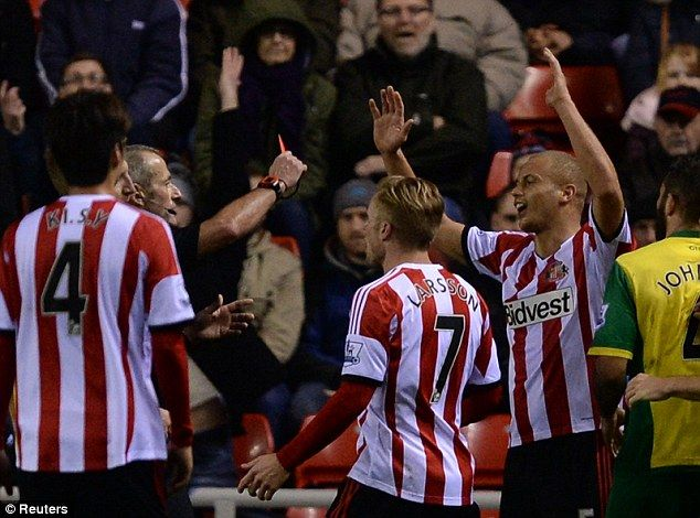 Marching orders: Wes Brown is shown a straight red card from Martin Atkinson in the 0-0 draw with Norwich City. Sunderland remain bottom of the table at Christmas.