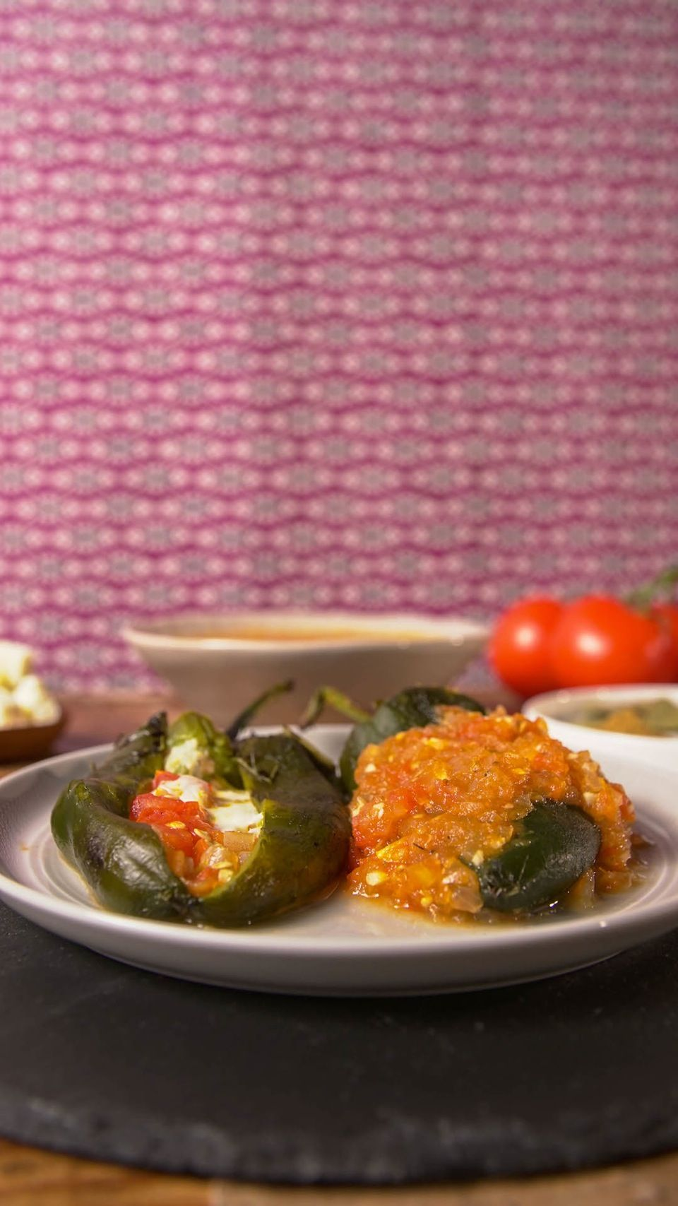 Recipe with video instructions: Chile rellenos are what happen when jalapeño poppers try adulting. Ingredients: 3 poblano peppers, About ½ lb of Oaxaca cheese (or any melting cheese of your choice), 2 ½ medium tomatoes, chopped, ½ chopped onion, 1 tsp oregano, ½ tsp cumin powder, Salt to taste, 2 squares of powdered chicken bouillon, A few bay leaves, Olive oil, to simmer sauce