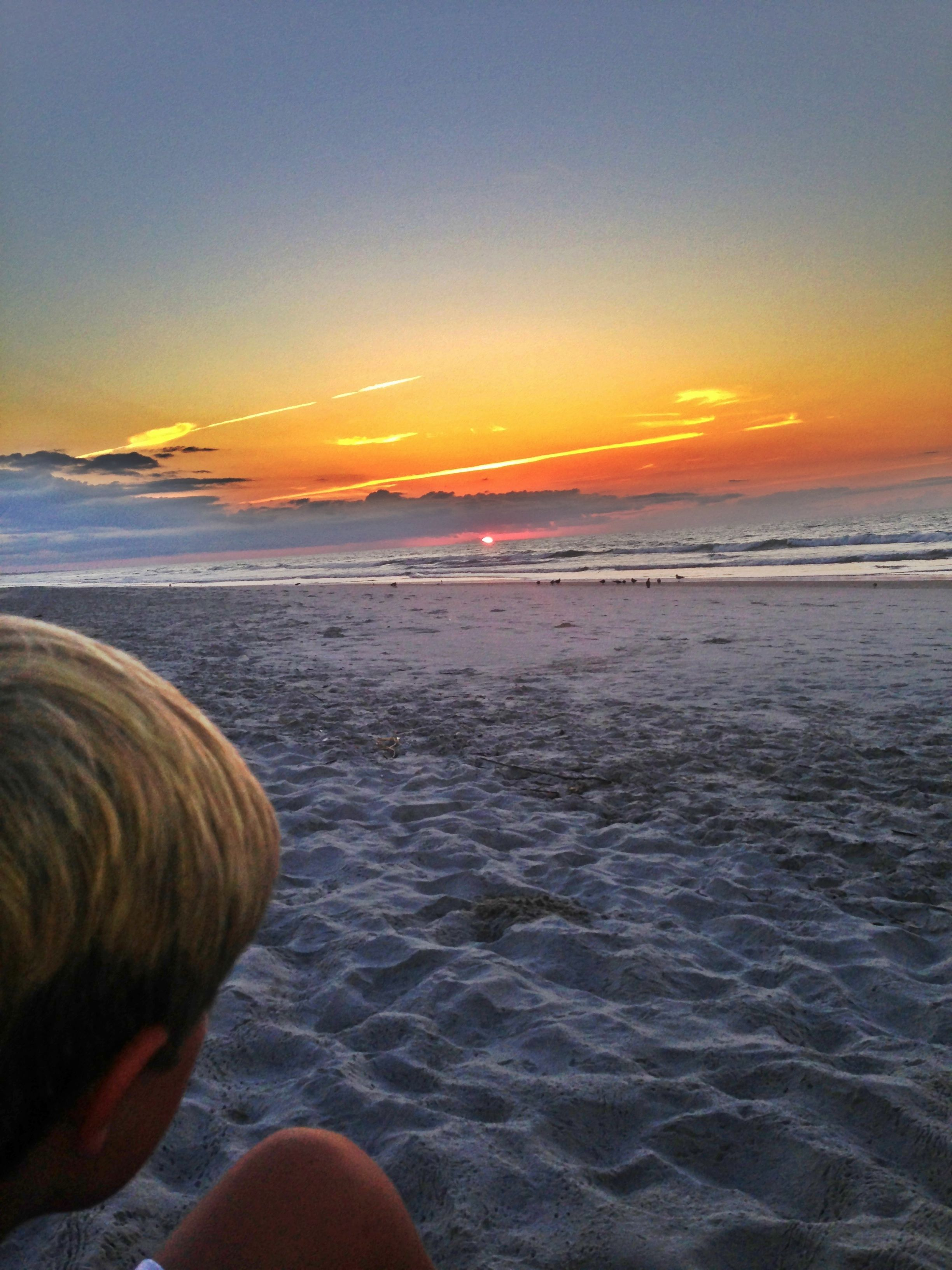 Grandson Max at sunrise on the beach!