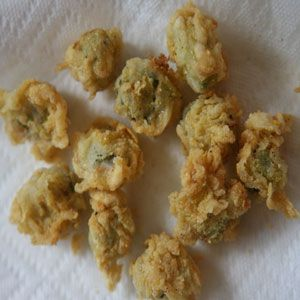 """Fried Okra  Buttermilk and Tabasco sauce add tang and spice to this fried okra, while cornmeal gives it a pleasant crunchiness. See """"State Plates: Oklahoma"""" for more on the official state meal, which consists of fried okra, stewed squash, pecan pie, and chicken fried steak."""