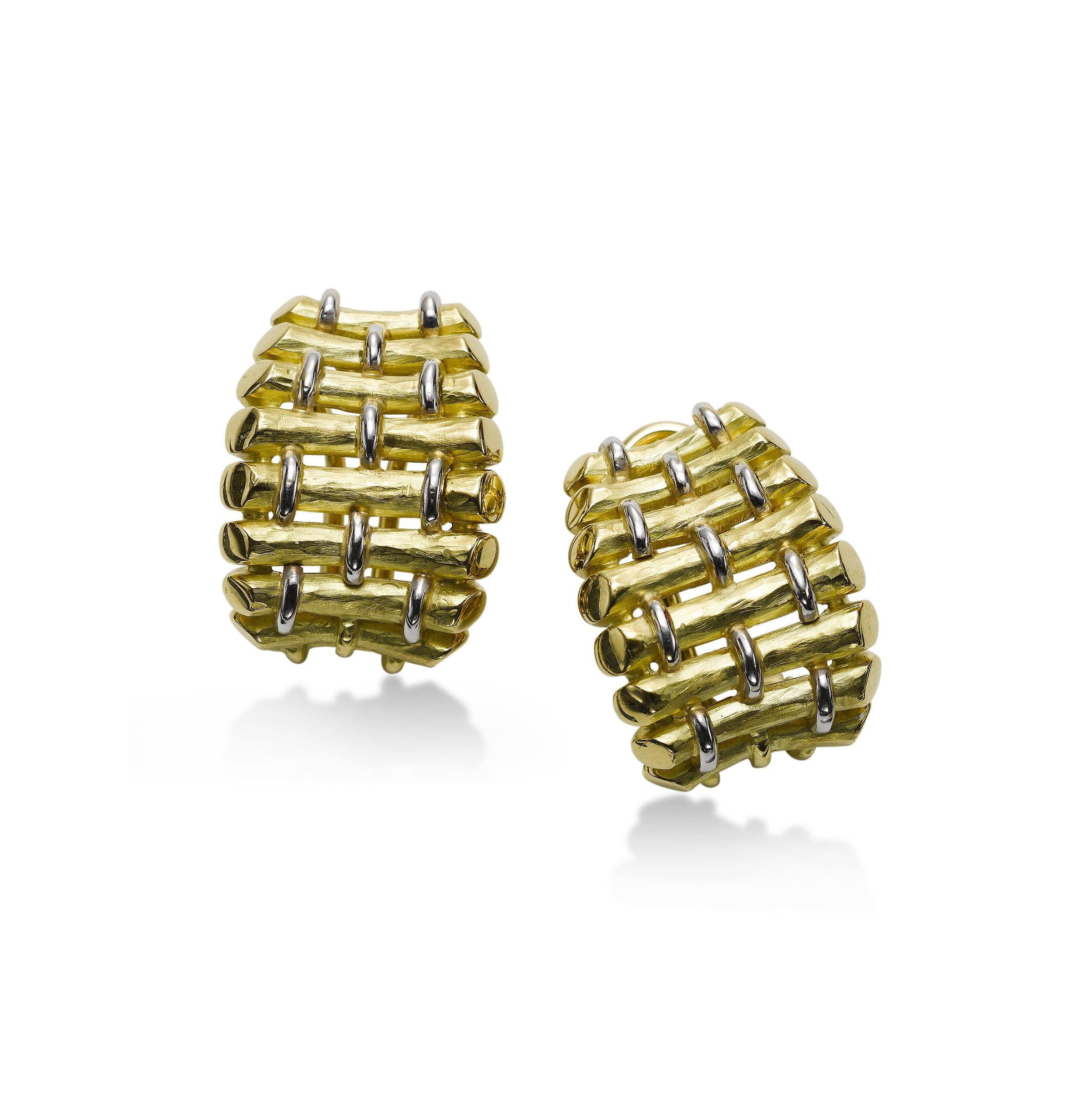 Gold earrings in a basket weave of white and yellow gold Theyure