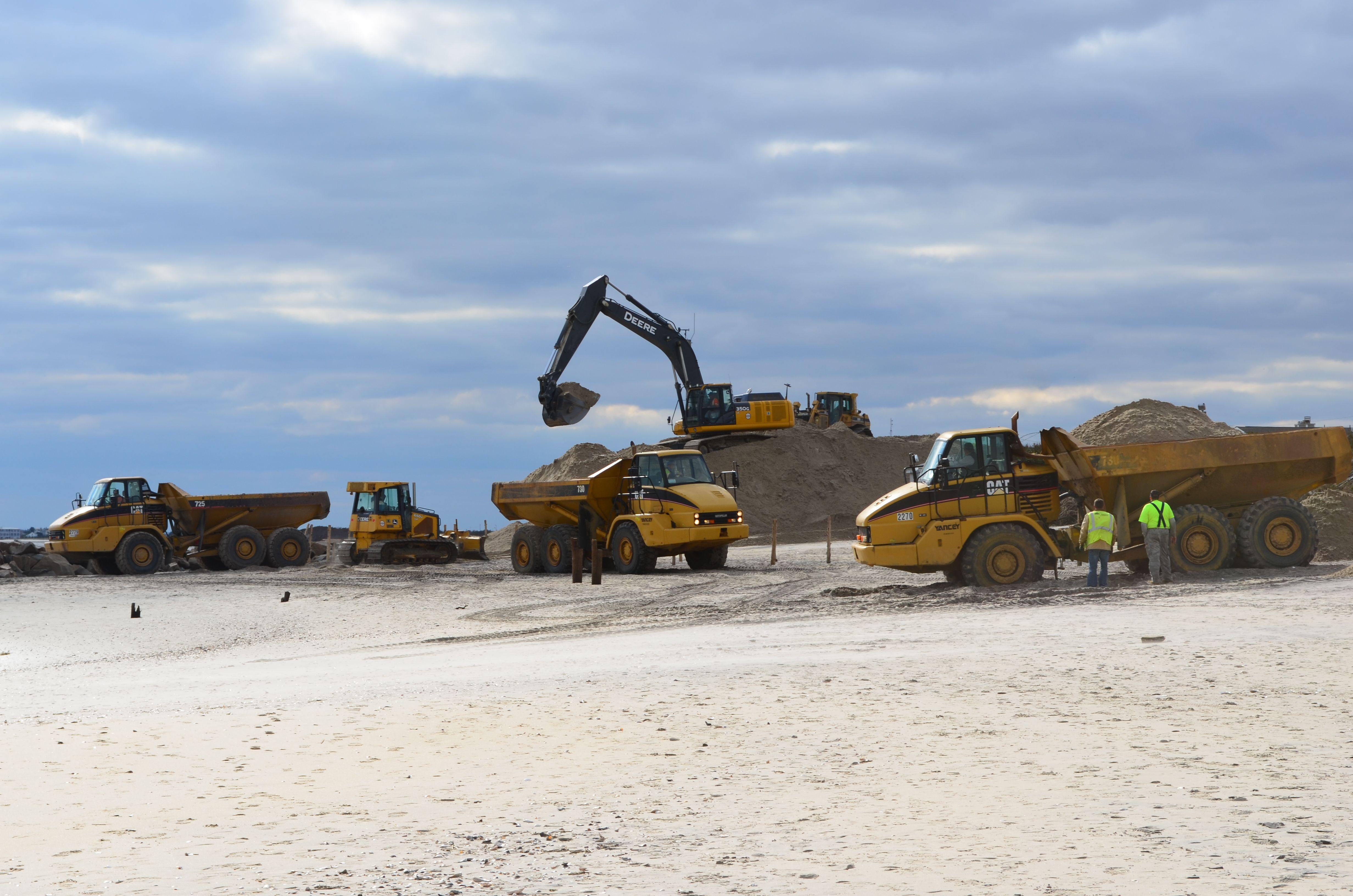 cat 730 725 articulated dump trucks taking sand from john deere