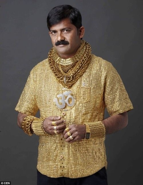 Spent $22,500 on a gold shirt to impress ladies!! How do you say Junebug in Hindi?