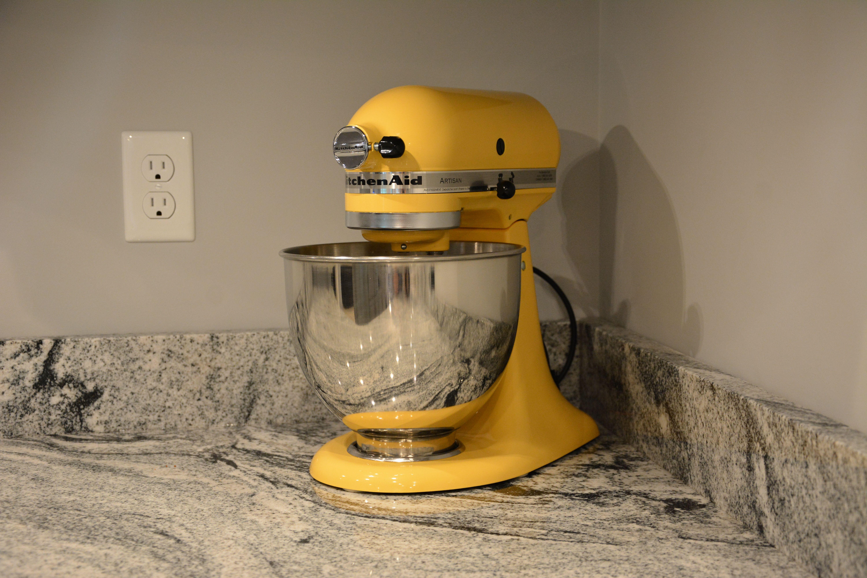 majestic yellow kitchen aid mixer on viscon white granite our