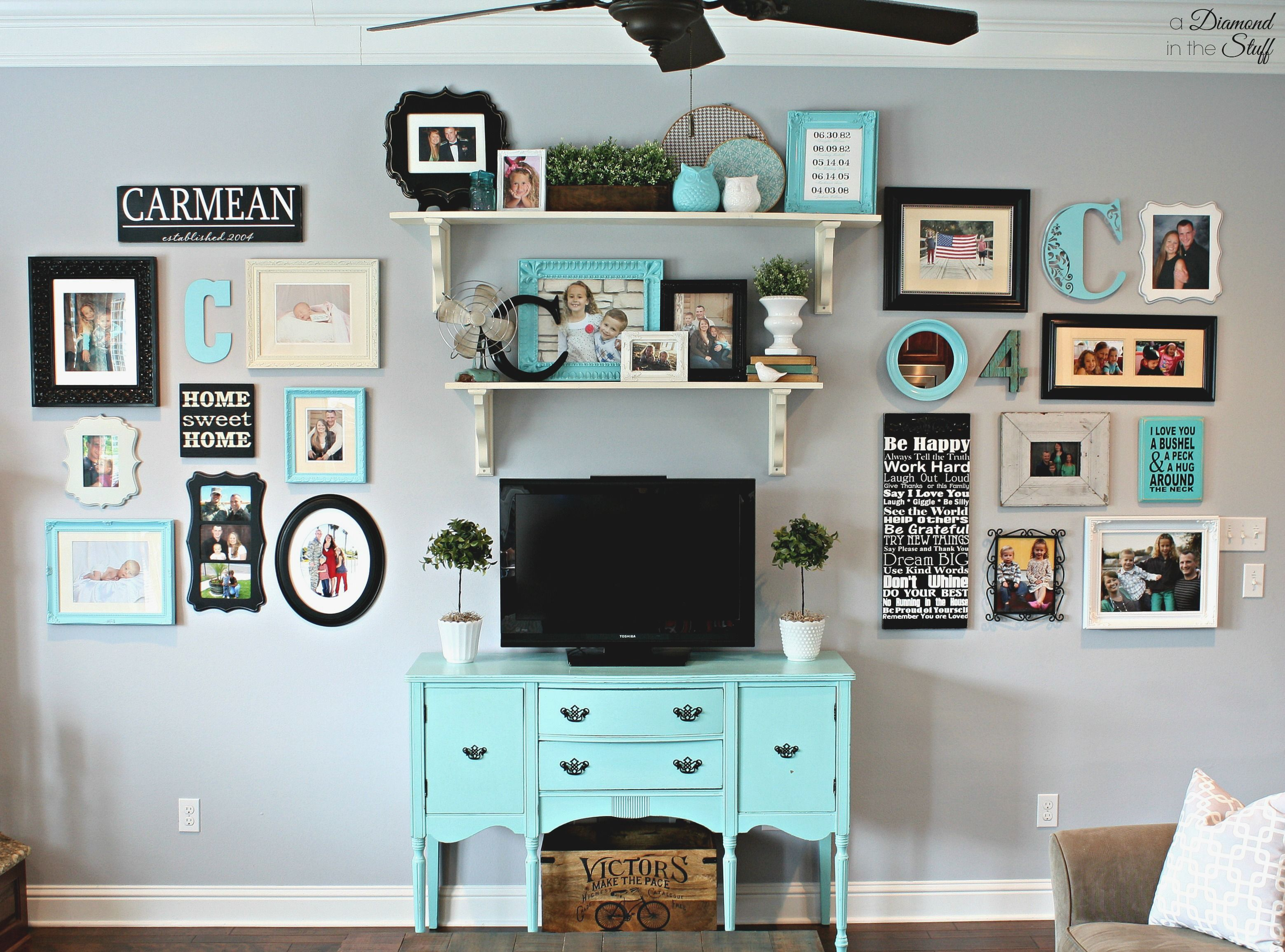 Bright Living Room Wall Gallery with turquoise cabinet, open ...