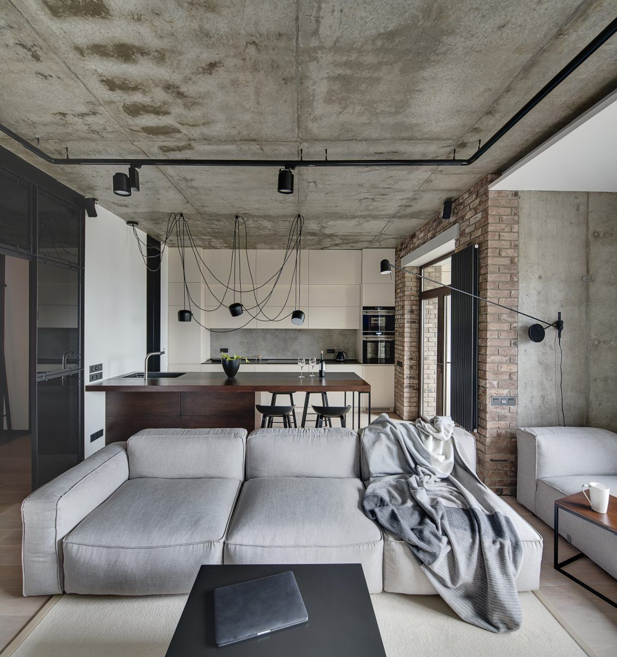 Schlafzimmer Loft Style Living-room And A Kitchen Zone In A Loft Style With Concrete And Brick Walls. | Living Room Loft, Minimalist Living Room, Loft Interiors