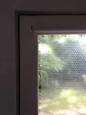 sticking bubble wrap to a glass window is a cheap and easy way to