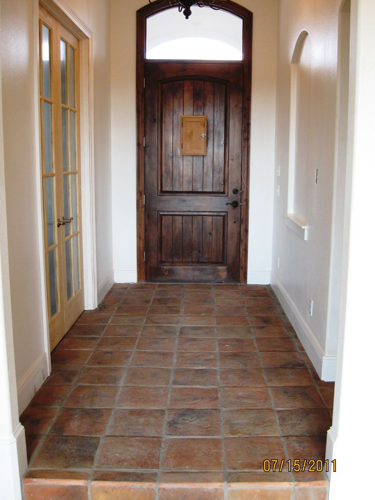 This entry is lined with Authentic Mexican flooring and the Antique Saltillo was also used throughout the kitchen. The terracotta really adds character to the Spanish style home.