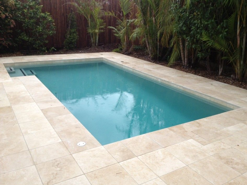 Spellbinding Travertine Pool Waterline Tile with Bamboo