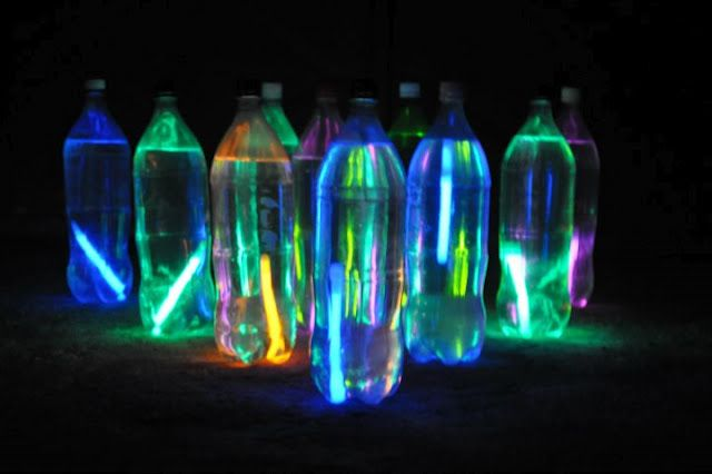 Glow in the dark bowling. How fun for camping or the backyard! -- Water bottles sans plastic label, water and glow sticks.  Midnight Madness Activity at Relay? Viola!