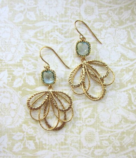 Aqua Feather Earrings by Marolsha.  https://www.etsy.com/listing/119756351/a-gold-plated-leaf-feather-dangle-aqua?ref=shop_home_active