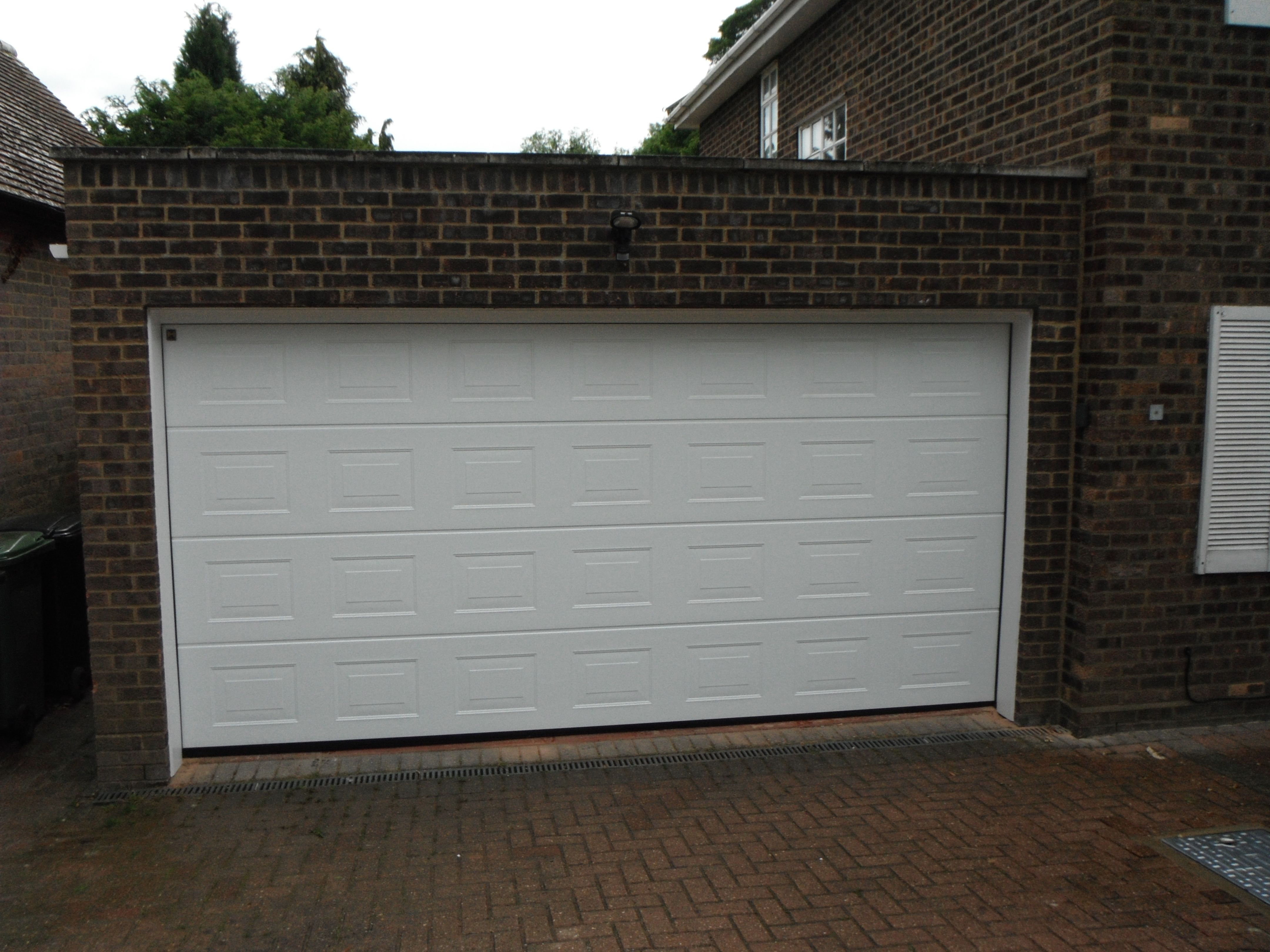 Hormann Double Sectional M Panel White Woodgrain Back Fix With White Upvc To Piers And Lintel To Cover Scarr Sectional Garage Doors White Paneling Garage Doors