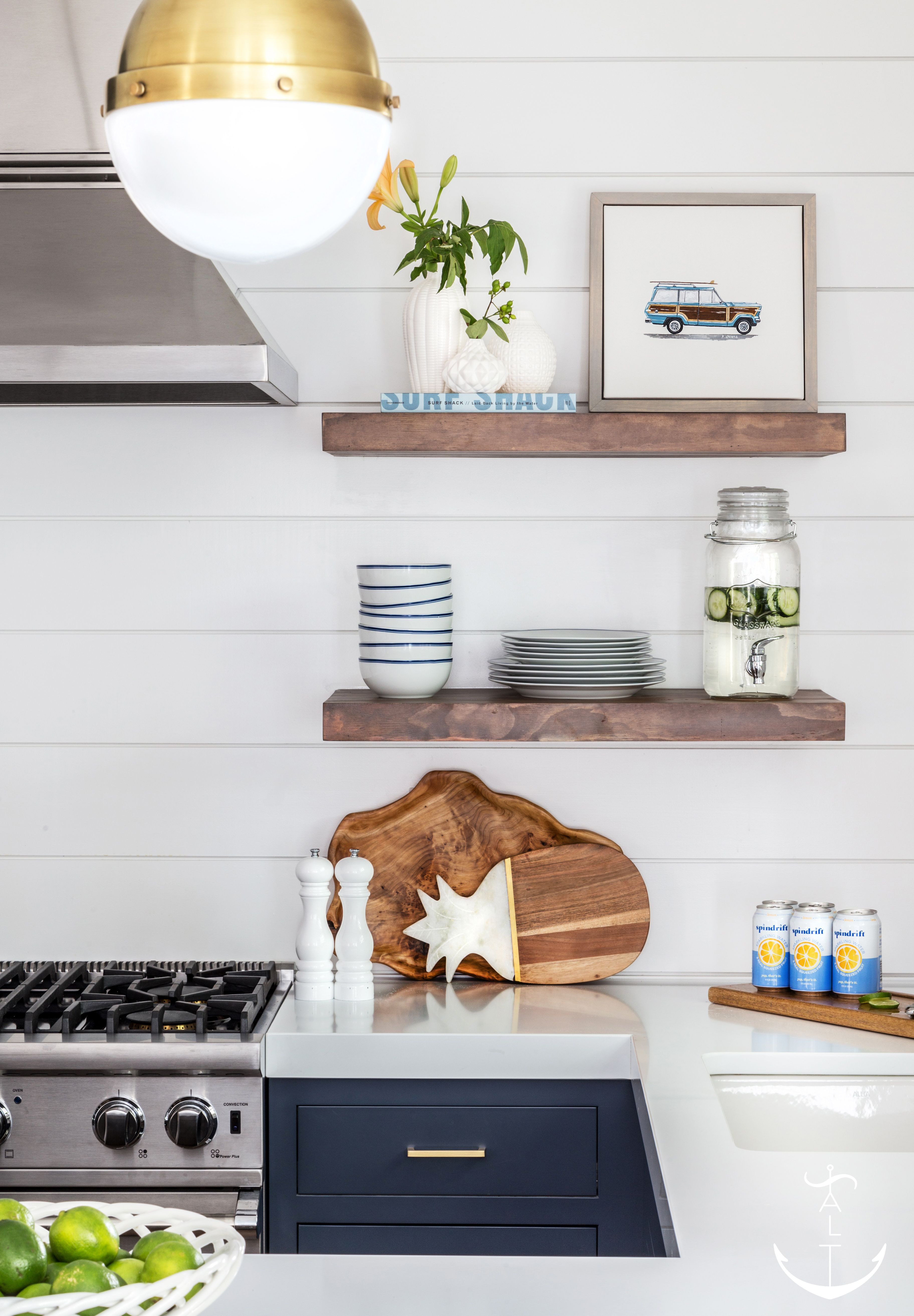 Beside A Stainless Steel Vent Hood, Wood Floating Shelves Are