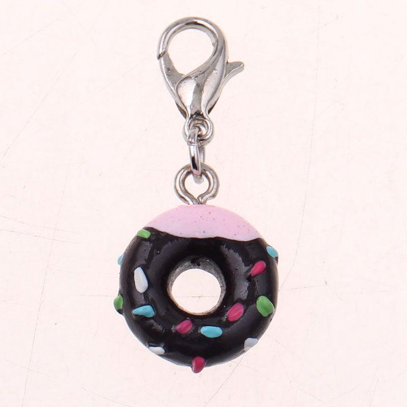 """Mignon petit porte Clés""""#Beignet / #Donuts"""" .Neuf sous blister.   Ce Porte Clés Fashion en Alliage de zinc peut s' accrocher à votre sac à main comme bijou et accessoire de mode.  Anneau en métal style Plaqué argent  Taille du petit porte donuts =1,4 cm"""