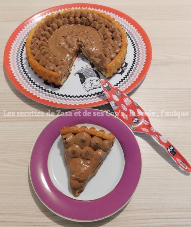 Tarte à l'ananas doré sur biscuit madeleine à la vanille et sa ganache montée au chocolat noir . - Les recettes de Zaza et de ses Cop's. #biscuitmadeleine Tarte à l'ananas doré sur biscuit madeleine à la vanille et sa ganache montée au chocolat noir . - Les recettes de Zaza et de ses Cop's. #biscuitmadeleine