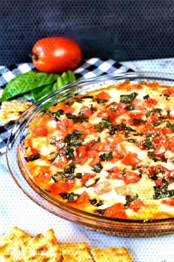 Tomato Basil Pizza Dip Tomato Basil Pizza Dip - gooey cheese loaded with fresh tomatoes and basil m