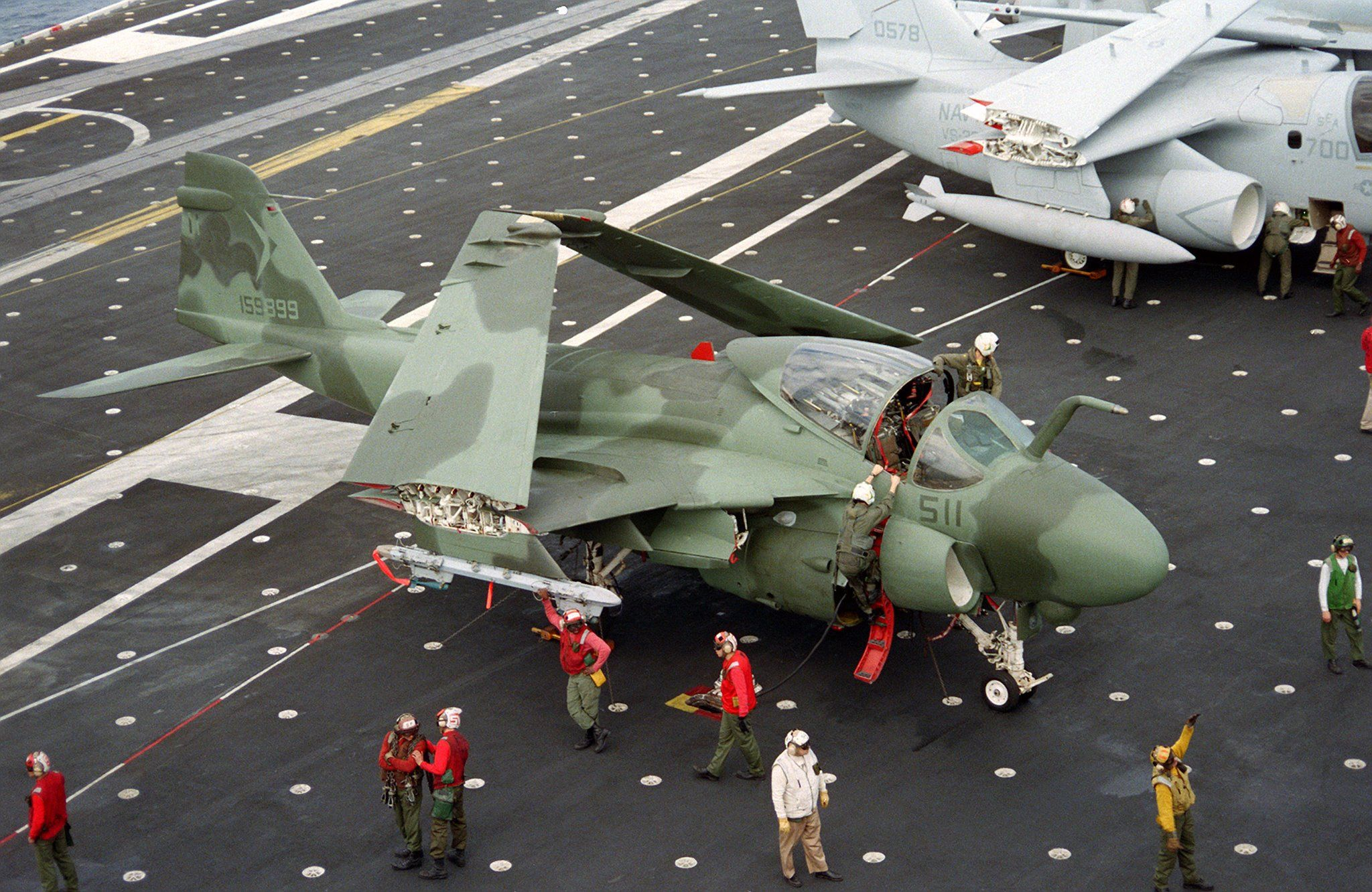 A rare photo pf an A-6E Intruder in green camouflage on the flight deck of the USS Constellation CV-64. This bird was assigned to VA-165, they were known as the Boomers