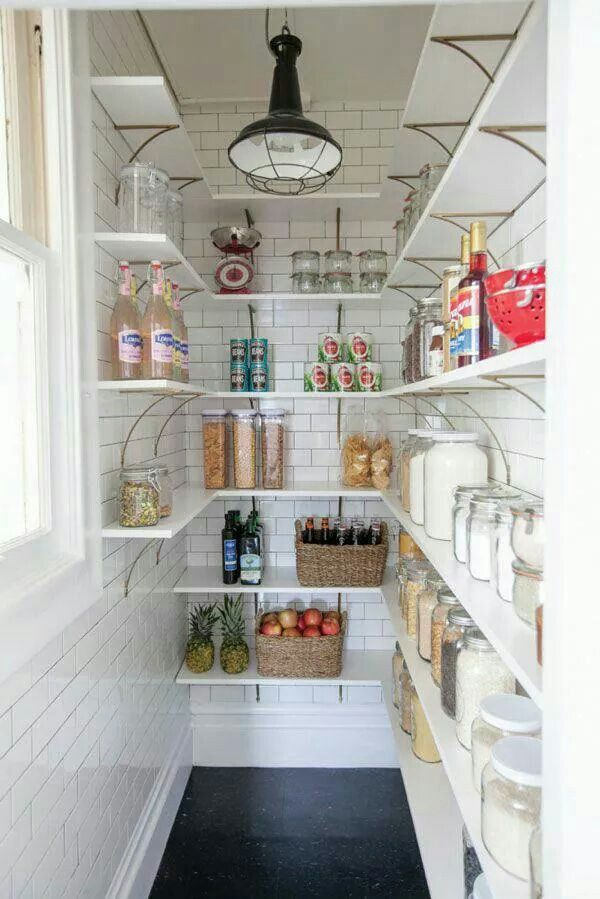 Dream pantry! I love the subway tile, dark grout, and gold brackets