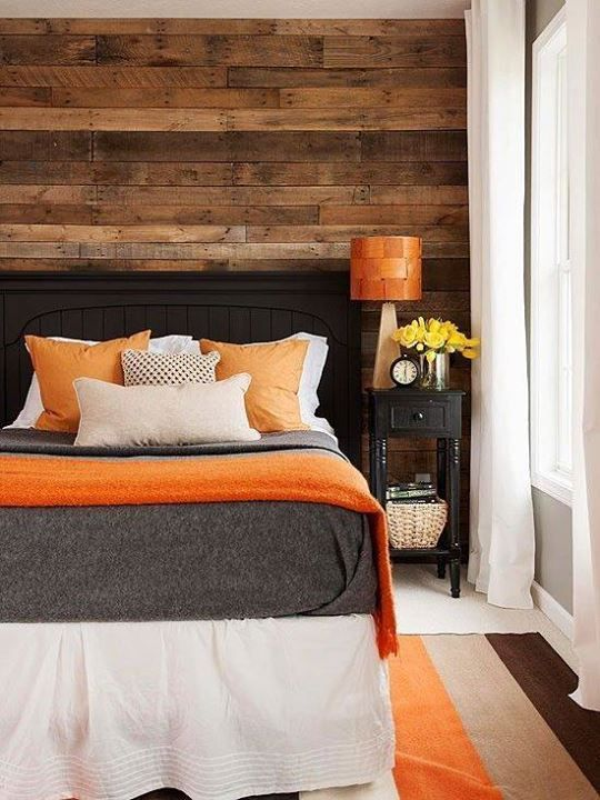 This bedroom is perfect. The wooden accent wall makes it all look even better.