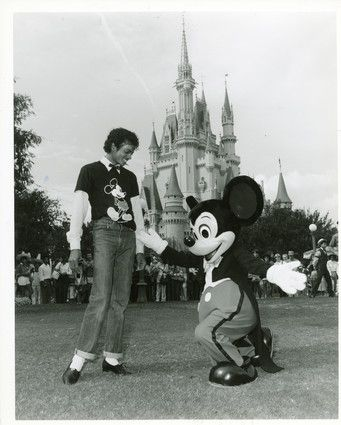 Mickey Mouse welcomes Michael Jackson to the Magic Kingdom during the singer's vacation visit to Walt Disney World in Florida. 1983.