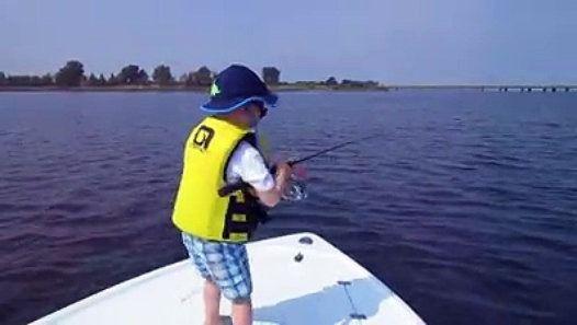 A Boy Fishing In A Professional Manner صبي يصطاد السمك بطريقة احترافية Bucket Hat