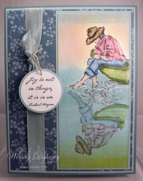 "Peaceful Water - HYCCT1215A  Summer by the Sea  Paper: Whisper White, Baja Breeze, Blue Bayou, Urban Garden DSP  Ink: Black, Various SU Markers  Accessories: 1 1/4"" Circle Punch, 1 3/8"" Circle Punch, Baja Breeze Seam Binding Ribbon, Linen Thread, White Gel Pen, Versa Marker, Clear Embossing Powder, Brayer, Sponge Daubers"