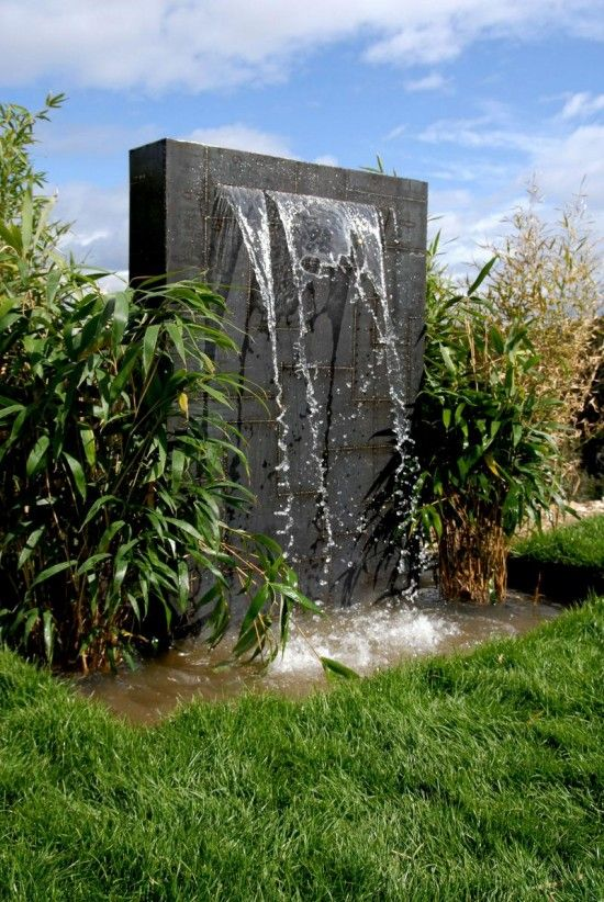 outdoor wall fountain install large stone at bottom before water disappears into the gravel - Outdoor Wall Designs