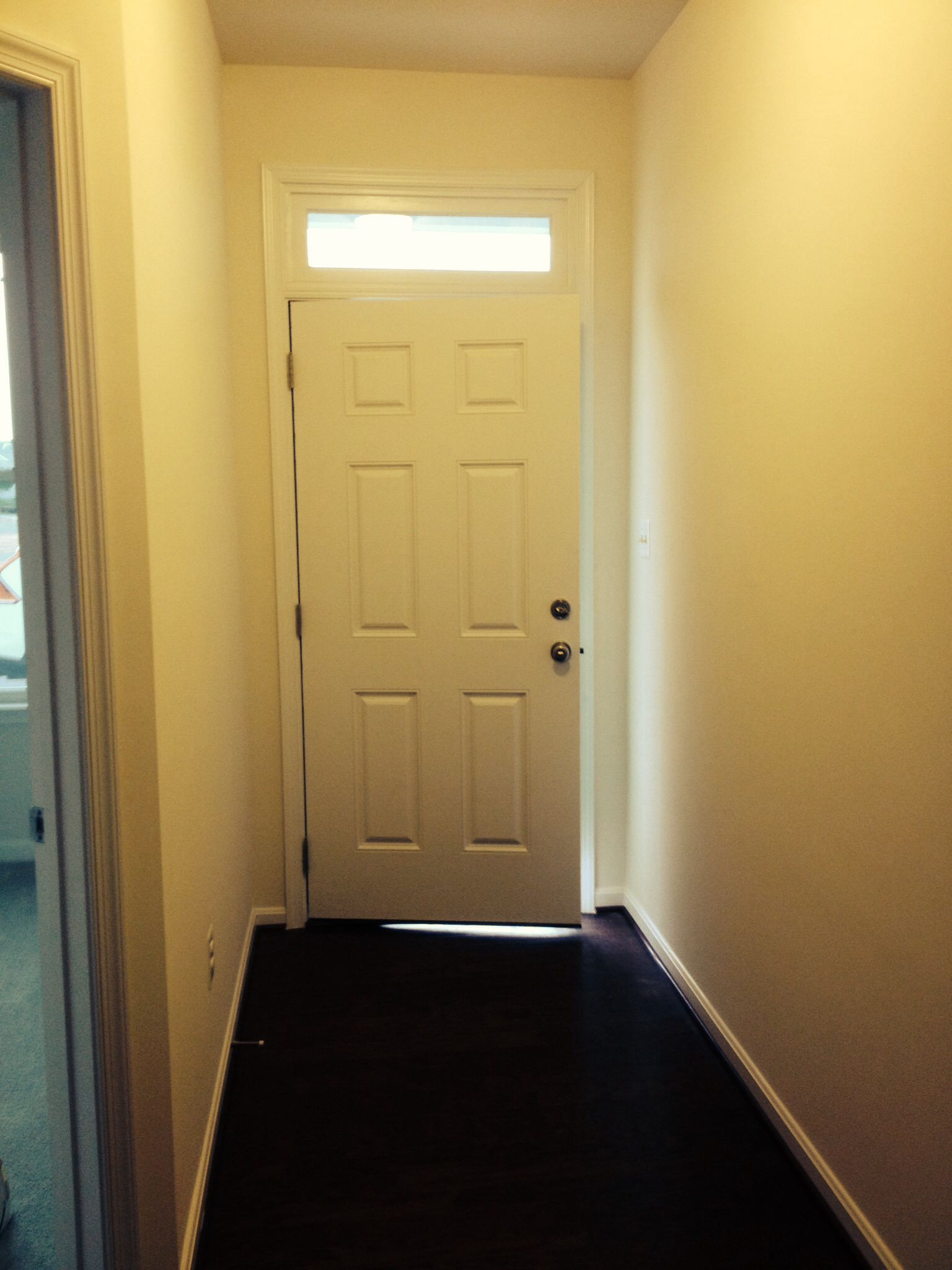 Foyer. Its a large one. Lots of wall space. Lots of room for a ...