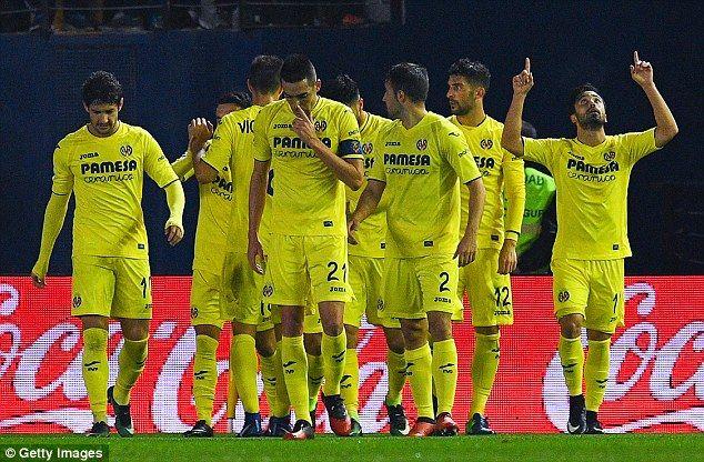 Villarreal players celebrate the first strike with goalscorer Manu Trigueros