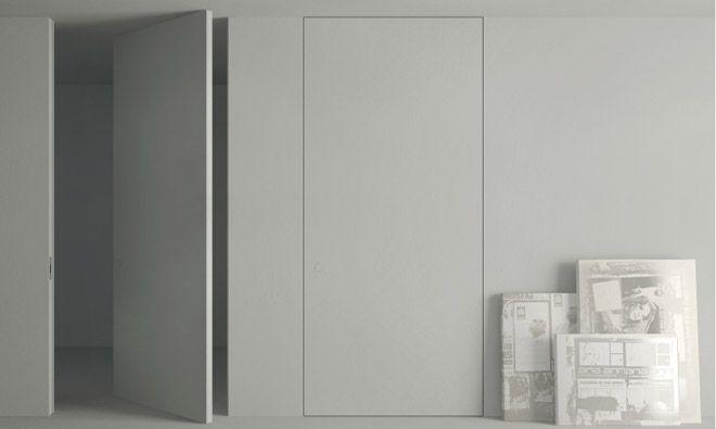 Porte battante à axe déporté invisible Secret à peindre Portes