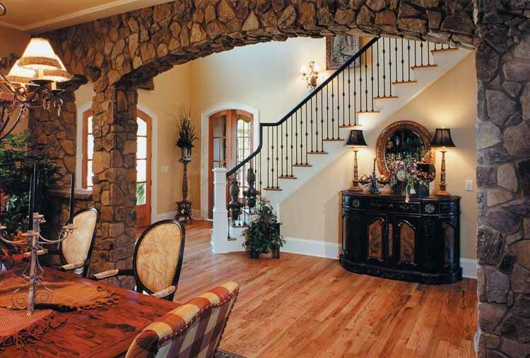 Not faux stone but    going to use this for inspiration beautiful rock archway and the staircase is so pretty also rh pinterest