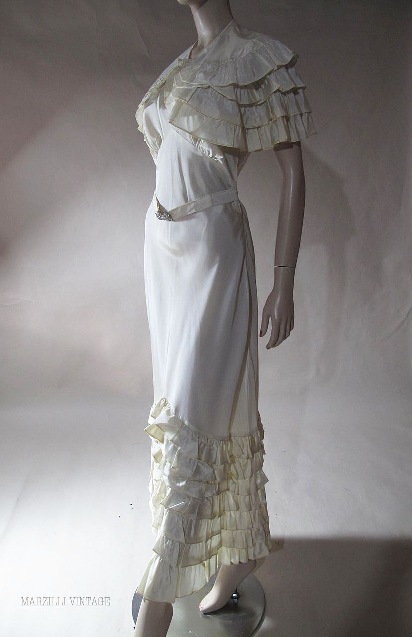 Flouncy us ivory taffeta bias cut evening gown with capelet