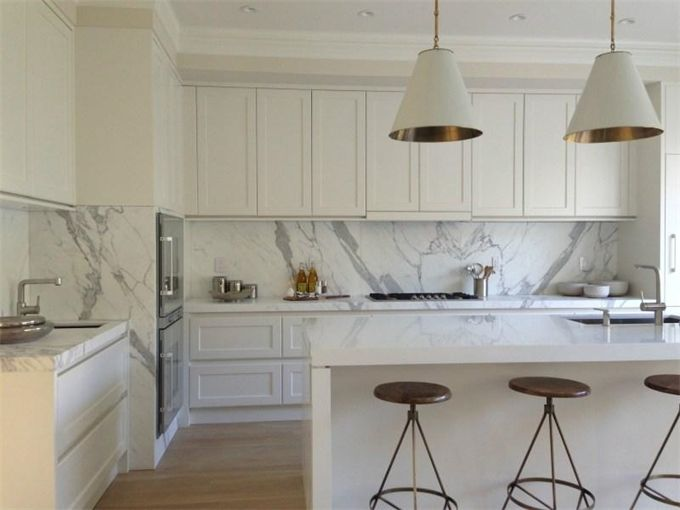 White shaker profile kitchen with calacatta marble timber
