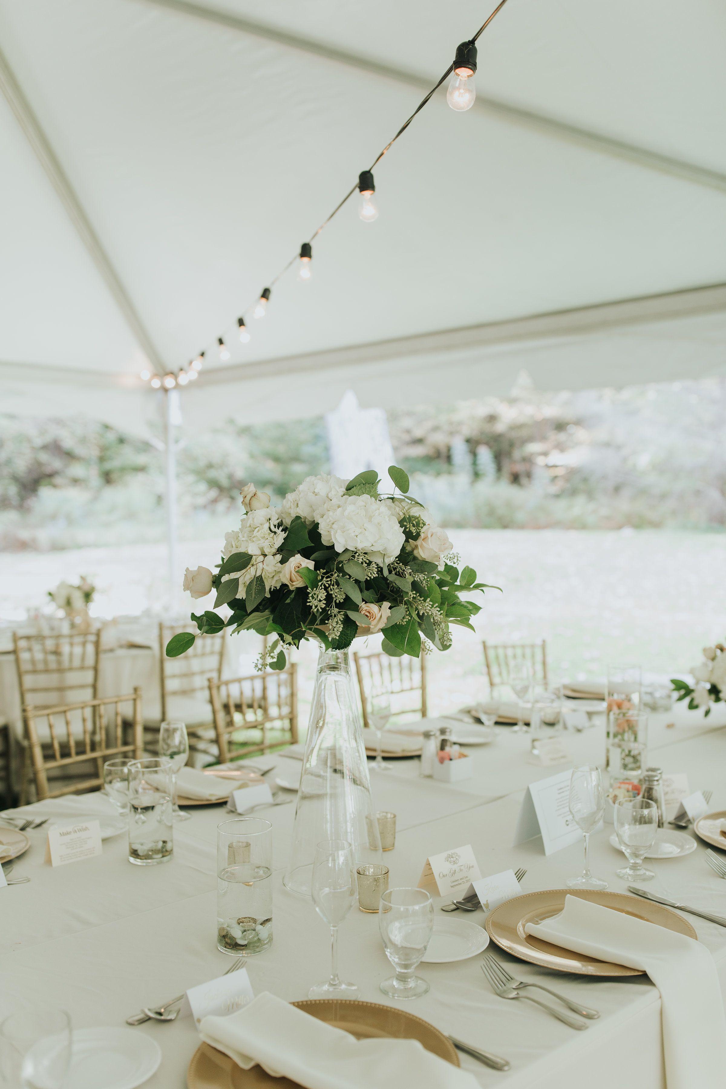 Trumpet vase centerpieces with seeded eucalyptus, roses, hydrangeas ...