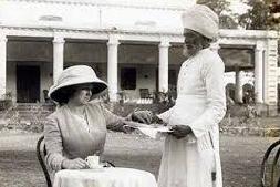 Last days of the raj. Sikh servant delivering afternoon tea.
